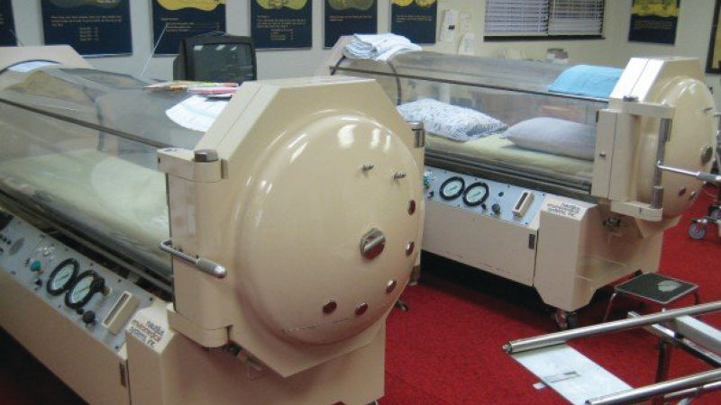 high-pressure hyperbaric oxygen treatment (HBOT),